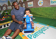 "New York Jet Shonn Greene and son Jeremiah join Pampers at the ""First Father's Day Cook-Out"" celebration in New York, Thursday, June 16, 2011.  The event, which celebrated dads for all that they do, was part of Pampers' Little Miracle Missions campaign that delivers acts of support to families and hopeful families in North America. Consumers can participate at www.Facebook.com/Pampers. (Diane Bondareff/AP images for Pampers)"