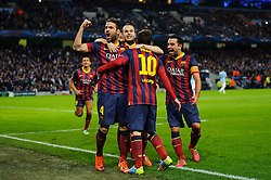 Barcelona Midfielder Lionel Messi (ARG) celebrates with Midfielder Cesc Fabregas (ESP) and Midfielder Andres Iniesta (ESP) after scoring a goal from a penalty - Photo mandatory by-line: Rogan Thomson/JMP - Tel: 07966 386802 - 18/02/2014 - SPORT - FOOTBALL - Etihad Stadium, Manchester - Manchester City v Barcelona - UEFA Champions League, Round of 16, First leg.
