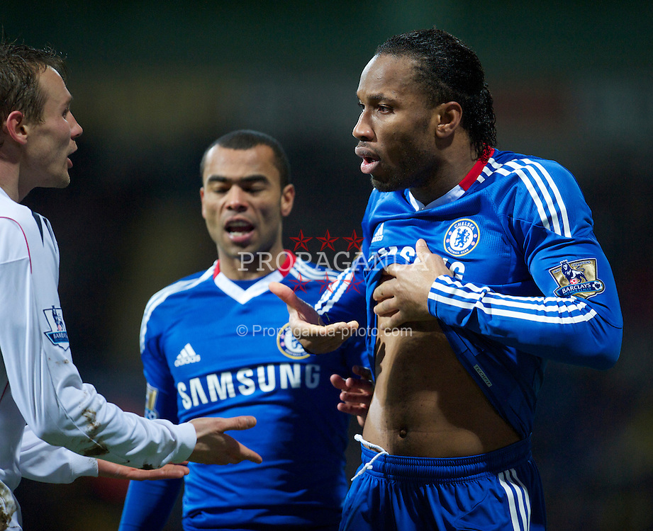 BOLTON, ENGLAND - Monday, January 24, 2011: Chelsea's Didier Drogba exposes himself to Bolton Wanderers players after feigning injury to win a free-kick during the Premiership match at the Reebok Stadium. (Photo by David Rawcliffe/Propaganda)