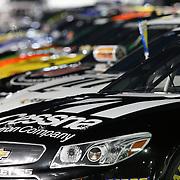 NASCAR race cars sit on the starting grid prior to the NASCAR Sprint Unlimited Race at Daytona International Speedway on Saturday, February 15,  2014 in Daytona Beach, Florida.  (AP Photo/Alex Menendez)