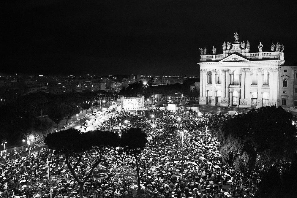 """ROME, ITALY - 22 FEBRUARY 2013: Beppe Grillo, a comedian and leader of the 5 Stars Movement (M5S, Movimento 5 Stelle) rallies during the last rally of his """"Tsunami Tour"""" in Piazza San Giovanni, in Rome on February 22, 2013. Wrapping up his election campaign in Rome, Grillo said """"there are 800,000 thousand of you here - with 150,000 watching our live streaming, and 120 squares in Italy watching us"""".<br /> <br /> Grillo, whom presents itself as a """"non-politician"""", and the 5 Stars Movement as """"not a party"""", has been running a mostly internet-based political campaign through the party's blog and the local groups that have emerged from it. The movement has a strong anti-politics agenda: """"All political parties are crooked and they all need to go"""", Grillo says.<br /> <br /> ###<br /> <br /> Roma, febbraio 2013. Circa 800.000 persone si presentano in Piazza San Giovanni per il comizio conclusivo dello Tsunami Tour di Beppe Grillo, leader del Movimento 5 Stelle, durante la campagna elettorale per le elezioni politiche.<br /> <br /> Grillo, il quale si presenta come un """"non-politica"""", e il Movimento 5 Stelle come un """"non-partito"""", svolge la maggior parte della propria campagna elettorale su internet, tramite il suo blog e i meetup locali. Il movimento ha un'agenda dalle connotazioni antipolitiche: """"I partiti sono finiti e i politici se ne devono andare"""", sostiene Grillo."""