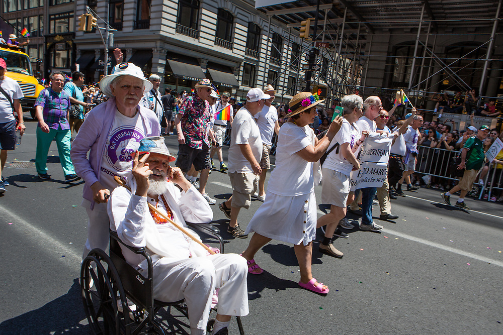 New York, NY - 30 June 2019. The New York City Heritage of Pride March filled Fifth Avenue for hours with participants from the LGBTQ community and it's supporters. Marchers included these members of the Gay Liberation Front, one of whom was in a wheelchair.