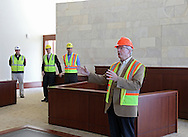City Council member Scott Olson asks a question in a courtroom during a tour of the new Federal Courthouse in Cedar Rapids on Tuesday morning, April 10, 2012. (Stephen Mally/Freelance)