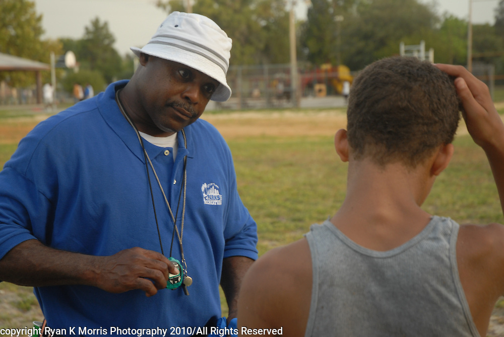 Images from the inaugural season of the Grant Park Tigers youth football and cheerleading team with the Unity Youth Football Conference. The city recreation center at the East Tampa neighborhood of Grant Park serves as a nucleus for children to play games and spend time after school and on the weekends instead of being on the streets. .Photos by Ryan K. Morris Photography