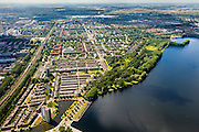 Nederland, Noord-Holland, Amsterdam, 14-06-2012; Overzicht van de wijk Slotervaart, met onder in beeld de nieuwbouwwijk Oostoever, met waterpartij, op de plaats van de voormalige rioolwaterzuivering West). Rechtsonder de Sloterplas, diagonaal de ringspoorbaan. Tussen de spoorbaan en de ring A10 (met vierkante flats) de wijk Overtoomse Veld...De wijken zijn onderdeel van de Westelijke Tuinsteden, gerealiseerd op basis van het Algemeen Uitbreidingsplan voor Amsterdam (AUP, 1935). Voorbeeld van het Nieuwe Bouwen, open bebouwing in stroken, langwerpige bouwblokken afgewisseld met groenstroken. .View on one of the western garden cities of Amsterdam Slotermeer.   Constructed on the basis of the General Extension Plan for Amsterdam (AUP, 1935). Example of the New Building (het Nieuwe Bouwen), detached in strips, oblong housing blocks alternated with green areas, built in fifties and sixties of the 20th century. Recreational lake Sloterplas  and  new constructed residential district.bottom picture..luchtfoto (toeslag), aerial photo (additional fee required).foto/photo Siebe Swart