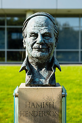 Bust of Hamish Henderson Scottish Poet and Songwriter at Edinburgh Park a modern business park at South Gyle in Edinburgh, Scotland, United Kingdom.