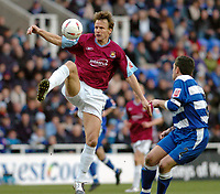 Photo. Leigh Quinnell.  Reading v West Ham United Coca Cola championship. 12/03/2005. West Hams Teddy Sheringham jumps for the ball watched by Readings Graeme Murty.