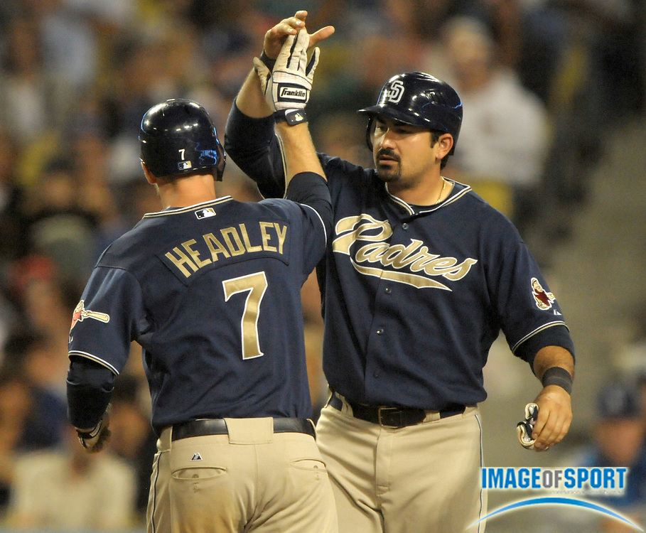 Aug 2, 2010; Los Angeles, CA, USA; San Diego Padres third baseman Chase Headley (7) is greeted by first baseman Adrian Gonzalez (23) after hitting a three-run home run in the sixth inning against the Los Angeles Dodgers at Dodger Stadium. Photo by Image of Sport