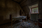 Stunning but Chilling images inside Abandoned creepy asylum<br /> <br /> This abandoned asylum  left in ruins and exposed to the elements.  Some people find these places creepy, others find them beautiful, but historic, haunting and eerie appeal.<br /> <br /> photographer Maikel Brands visited this abandoned creepy asylum located  in Belgium. It was built in the early years of the 20th century. At the end of the same century the building was abandoned, <br /> Maikel said  &quot;I really love the style of this building but it also has something creepy about it&quot; <br /> <br /> &quot;Once inside the vibe is even more creepy&quot;<br /> <br /> &quot;The beds with the steel bars in the tiny dark rooms gave me the shivers down my spine&quot; <br /> &copy;Maikel Brands/Exclusivepix Media