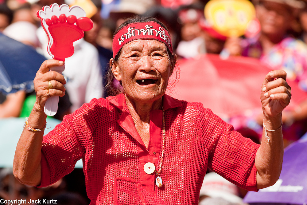 "09 MAY 2010 - BANGKOK, THAILAND: A Red Shirt woman cheers for Red Shirt speakers at the Red Shirt rally in Bangkok Sunday. The Red Shirt leaders said Sunday they still conditionally supported the Prime Minister's ""Road Map to Reconciliation"" but that their opponents the Yellow Shirts needed to sign on to make the five point ""Road Map"" viable. About 5,000 people mostly from northeast Thailand, joined the Red Shirts in Ratchaprasong over the weekend. Members of the United Front of Democracy Against Dictatorship (UDD), also known as the ""Red Shirts"" and their supporters have occupied Ratchaprasong intersection, the site of Bangkok's fanciest shopping malls and several 5 star hotels, since April 4. The Red Shirts are demanding the resignation of current Thai Prime Minister Abhisit Vejjajiva and his government. The protest is a continuation of protests the Red Shirts have been holding across Thailand. They support former Prime Minister Thaksin Shinawatra, who was deposed in a coup in 2006 and went into exile rather than go to prison after being convicted on corruption charges. Thaksin is still enormously popular in rural Thailand.   PHOTO BY JACK KURTZ"
