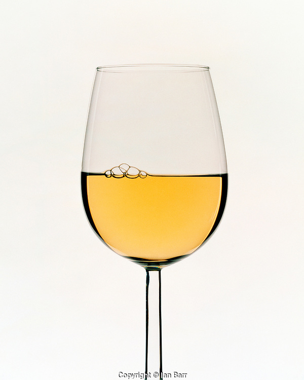 Graphic shot of white wine on white background,