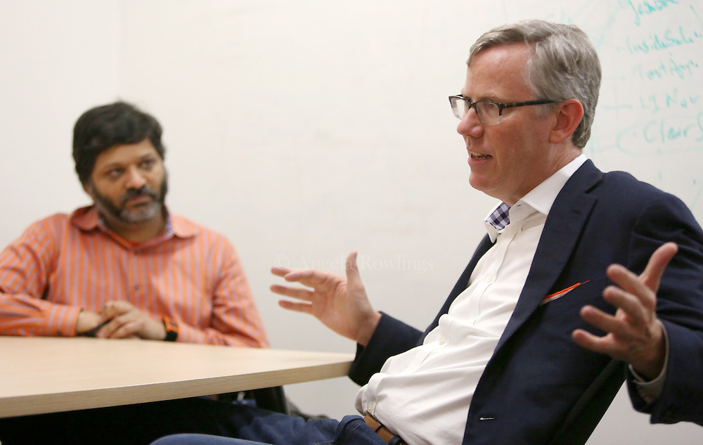 (Cambridge, MA - 5/19/15) Dharmesh Shah, left, listens as fellow HubSpot co-founder Brian Halligan talks with a reporter, Tuesday, May 19, 2015. Staff photo by Angela Rowlings.