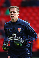 Wojciech Szczesny of Arsenal warms up before the Barclays Premier League match at Anfield, Liverpool<br /> Picture by David Horn/Focus Images Ltd +44 7545 970036<br /> 08/02/2014