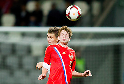 Pavel Mogilevets of Russia vs Blaz Vrhovec of Slovenia during football match between U21 National Teams of Slovenia and Russia in 6th Round of U21 Euro 2015 Qualifications on November 15, 2013 in Stadium Bonifika, Koper, Slovenia. Russia defeated Slovenia 1-0. Photo by Vid Ponikvar / Sportida