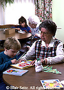 Active Aging Senior Citizens, Retired, Activities, Elderly Woman with Grandchild, Crafts Room, Retirement Community