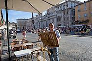 Roma 6 Agosto 2014<br /> Sono tornati per pochi minuti i dehors a Piazza Navona. I titolari dei ristoranti  hanno deciso di alzare le saracinesche e ripristinare gli spazi esterni, ma posizionando i tavolini nel rispetto dei limiti imposti dalle concessioni del comune di Roma. Ma gli agenti della municipale li hanno bloccati: &quot;Non sono autorizzati&quot;. Un ristoratore rimuove i tavolini  per ordine della Polizia Municipale,perch&egrave; non in regola con  i limiti imposti dalle concessioni del comune di Roma.<br /> Rome August 6, 2014 <br /> They came back for a few minutes the dehors in the Piazza Navona. The owners of the restaurants have decided to raise the  rolling shutter and restore the dehors, but by placing the tables within the limits imposed by the concessions of the city of Rome. But the agents of the municipal blocking them: &quot;They are not unauthorised &quot;. A caterer removes the tables by order of the Municipal Police, why do not comply with the limits imposed by the concessions of the city of Rome.