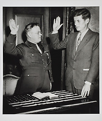 May 16, 2017 - U.S. - File Photo - Kennedy in 1946 being sworn in as commander of VFW POST NO. 5880 which JFK formed to honor his late brother Lt. Joseph P. Kennedy Jr. whose banner he marched behind on June 17, 1946 in the annual Bunker Hill Day Parade. In very fine museum-quality condition. A fantastic image of the young Kennedy. In commemoration of JFK's 100th birthday on May 29, 2017, RR Auction has curated an once-in-a-lifetime assortment of Kennedy artifacts, signed material, and photographs to celebrate the life of America's beloved 35th president. The more than 175 lots cover; JFK's early years, the transition to his congressional and senatorial careers, and 'The 1,000 Days of Camelot,' Kennedy's storied tenure as president. The special online offering is scheduled to begin on May 11 and will conclude on May 18, 2017. The R. Paloger photographs shows a period in JFK's life from 1946 to 1953, chronicling JFK's first political congressional campaign of 1946, his run for U.S. senator in 1952, and his marriage to Jackie in 1953. (Credit Image: © Ronnie Paloger/RR Auction via ZUMA Wire/ZUMAPRESS.com)