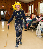 "Hazel Cook begins the Friendship Club's Fashion Show sporting humor in a pair of stylish and comfortable ""baggy"" pants and a smart ""tee"" shirt.  Her pretty sunhat completes the outfit as she hits the runway at Leavitt Park on Wednesday afternoon.  (Karen Bobotas/for the Laconia Daily Sun)"