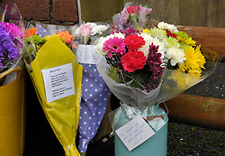 © Licensed to London News Pictures. 28/01/2013. Bristol, UK. Flowers and tributes are left at the scene where two cyclists, husband and wife Ross and Claire Simons, died after they were involved in a hit and run accident yesterday (27 January) with a vehicle in Lower Hanham Road, Hanham, Bristol.  The police have said they tried to flag the vehicle down before the accident because it was going at speed.  28 January 2013..Photo credit : Simon Chapman/LNP