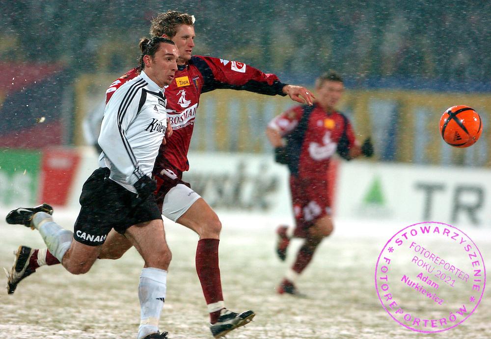 n/z.: Marek Saganowski (nr10-Legia), Pawel Magdon (nr17-Pogon) podczas meczu ligowego Legia Warszawa (biale) - Pogon Szczecin (czerwone) 3:0 , I liga polska , 14 kolejka sezon 2004/2005 , pilka nozna , Polska , Warszawa , 11-03-2005 , fot.: Adam Nurkiewicz / mediasport..Marek Saganowski (nr10-Legia), Pawel Magdon (nr17-Pogon) fight for the ball during Polish league first division soccer match in Warsaw. March 11, 2005 ; Legia Warszawa (white) - Pogon Szczecin (red) 3:0 ; first division , 14 round season 2004/2005 , football , Poland , Warsaw ( Photo by Adam Nurkiewicz / mediasport )