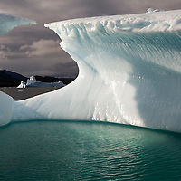 Greenland, Nanortalik, Icebergs floating along western coast near Ilukasik Island on summer evening