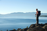 Young man hiking above Lake Tahoe, CA.