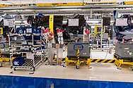 CASSINO, ITALY - NOVEMBER 24:  Employees works in the Assembly Lines where they assemble the Alfa Romeo Giulia in the Cassino Assembly Plant FCA Group. In this area it takes place manual work this is why new workstations designed to reduce fatigue and improve ergonomics have been introduced on November 24, 2016 in Cassino, Italy.