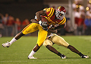 September 26, 2009: Iowa State wide receiver Marquis Hamilton (82) tries to get away from Army cornerback Mario Hill (1) during the second half of the Iowa State Cyclones' 31-10 win over the Army Black Knights at Jack Trice Stadium in Ames, Iowa on September 26, 2009.