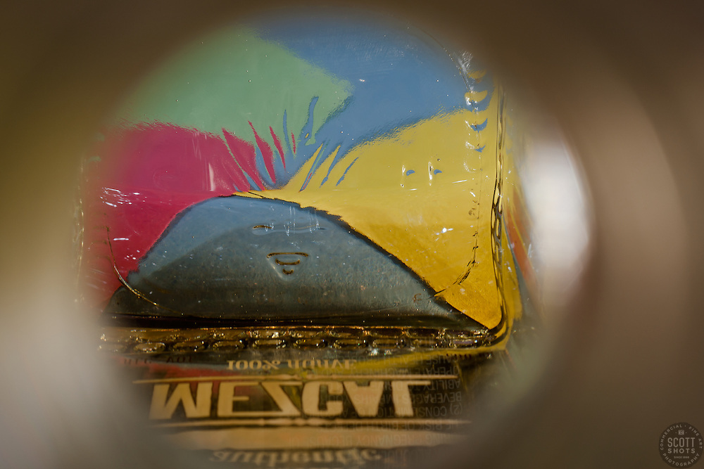 """Beauty at the Bottom: Mezcal 1"" - This is a photograph of a mezcal bottle, shot right down inside the mouth of the bottle."