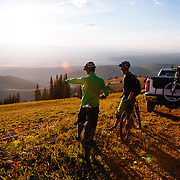 Jake Hawkes and Andrew Whiteford scope singletrack lines at Grand Targhee Mountain Resort in Wyoming.