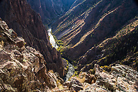 Looking down into the Black Canyon and the Gunnison River from Pulpit Rock Overlook along the South Rim.  Black Canyon of the Gunnison National Park, Colorado.