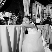 A tired guest at Erin and Joe's wedding reception at the Green Building in Brooklyn, New York.