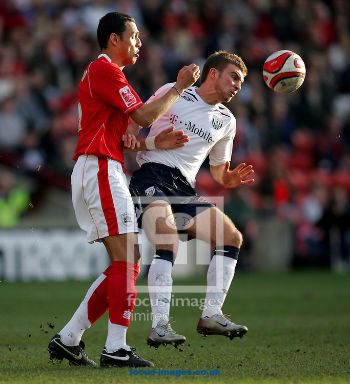 Barnsley - Saturday February 9th, 2008: Anderson De Silva of Barnsley and James Morrison of West Bromwich Albion during the Coca Cola Championship match at Oakwell stadium, Ipswich. (Pic by Paul Hollands/Focus Images)