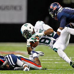 September 22, 2012; New Orleans, LA, USA; Tulane Green Wave wide receiver Xavier Rush (82) is tackled by Ole Miss Rebels defensive back Dehendret Collins (1) during the second quarter of a game at the Mercedes-Benz Superdome.  Mandatory Credit: Derick E. Hingle-US PRESSWIRE