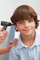 Boy having his ear examined