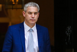 "© Licensed to London News Pictures. 20/03/2019. London, UK. Stephen Barclay- Brexit Secretary departs from No 10 Downing Street. According to No 10 Downing Street, later today British Prime Minister Theresa May will write to European Union chiefs requesting a ""short"" delay to the date Britain leaves the EU. Photo credit: Dinendra Haria/LNP"