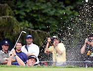 Phil Mickelson of the US chips from a trap on the fifteenth hole during the first day of the US Open Golf Championship at Winged Foot Golf Club in Mamaroneck, New York Thursday, 15 June 2006.