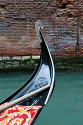 Gondola detail on small canal in Venice Italy