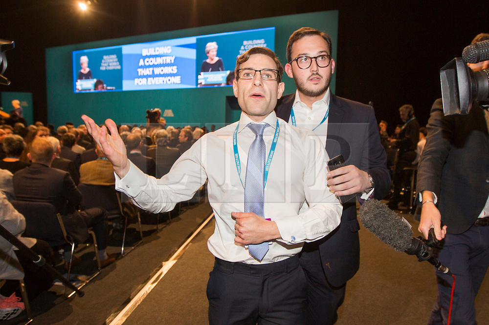 © Licensed to London News Pictures. 04/10/2017. Manchester UK. Prankster Lee Nelson is removed from the Conservative party conference after handing Theresa May a P45 during her speech on the third & final day of the Conservative Party Conference today in Manchester. Photo credit: Andrew McCaren/LNP