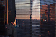 New York - 11 times square  plaza tower in Midtown, reflection of New york wkyline on a mirror tower . / reflet sur la tour du 11 Times square.