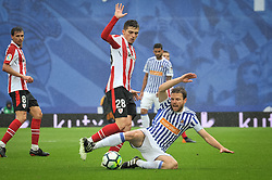 April 28, 2018 - San Sebastian, Spain - Cordoba of Athletic Club  duels for the ball with Illarramendi of Real Sociedad during the Spanish league football match between Real Sociedad and AtHletic Club Bilbao at the Anoeta Stadium on 28 April 2018 in San Sebastian, Spain  (Credit Image: © Jose Ignacio Unanue/NurPhoto via ZUMA Press)