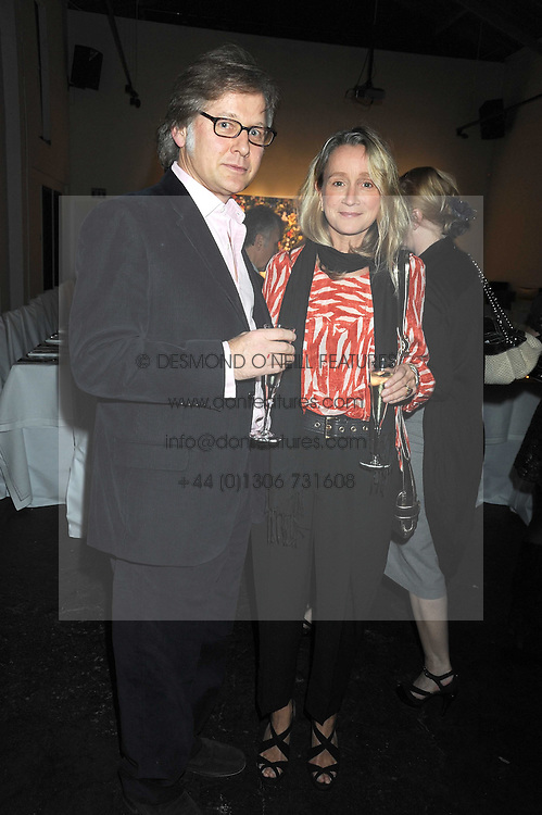 SIMON CROWE and Vogue fashion editor LUCINDA CHAMBERS at an exhibition entitled 'Cut Flowers' by Robin Derrick held at 70a Silverthorne Road, London SW8 on 8th October 2008.