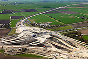 Nederland, Friesland, Leeuwarden, 01-05-2013; aanleg N31 de Haak om Leeuwarden. Bouw nieuw knooppunt Werpsterhoek, kruising spoorlijn naar Heerenveen..De nieuwe rijksweg vormt de verbinding tussen de huidige A31 bij Marsum en de N31 bij Hemriksein (Wâldwei)..Construction of new motorway junction of the N31, crossing the railway Leeuwarden - Heerenveen..luchtfoto (toeslag op standard tarieven).aerial photo (additional fee required).copyright foto/photo Siebe Swart