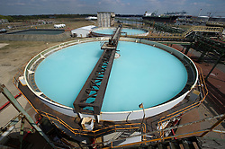 The blue water in the brine tanks is caused by the high concentration of salt, which is used to make chlorine, at the Solvay SA chemical plant in Antwerp, Belgium, on Thursday, April 22, 2010.  Solvay SA is the world's largest supplier of Soda Ash or Sodium Carbonate and is also a major producer of caustic soda, hydrogen peroxide, chlorine and fluorinated products. (Photo © Jock Fistick)