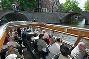 Grachten sightseeing by boat...M.S. Johann Strauss, a brand new four star+ river cruiser operated by Austrian River Cruises, and chartered by Club 50 (a travel agency especially for seniors aged 50 and up) undertook an epic 3-week journey (May 21 to June 10, 2004) all the way from Amsterdam to the Black Sea?along Rhine, Main and Danube?, presumably the first passenger vessel ever to have done so. This is one of the images recorded during this historic voyage.