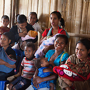 Food is served for a Mother Support Group session where breast feeding mothers with 4 months plus babies learn about food supplements.Food workshop Billum Hatu, hamlet of Madabenu. Aidiu district..Food Demonstration.. Infant mortality rates are very high in Timor-Leste and one of the reasons for that is poor nutrition. Alola advocate breast feeding till at least two years old and teach women about nutritious supplements such as boiled and mashed rice w vegetables and eggs.  Fundasaun Alola is a not for profit non government organization operating in Timor Leste to improve the lives of women and children. Founded in 2001 by the then First Lady, Ms Kirsty Sword Gusmao, the organization seeks to nurture women leaders and advocate for the rights of women.