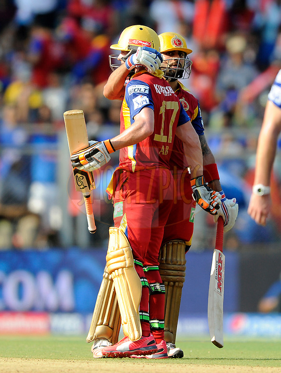 AB De Villiers of Royal Challengers Bangalore is congratulated by his teammate Virat Kohli captain of Royal Challengers Bangalore as the earlier reaches his half century during match 46 of the Pepsi IPL 2015 (Indian Premier League) between The Mumbai Indians and The Royal Challengers Bangalore held at the Wankhede Stadium in Mumbai, India on the 10th May 2015.<br /> <br /> Photo by:  Pal Pillai / SPORTZPICS / IPL