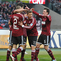 17.02.2013, easyCredit Stadion, Nuernberg, GER, 1. FBL, 1. FC Nuernberg vs Hannover 96, 22. Runde, im Bild Die Spieler des 1.FC Nuernberg bejubeln das Tor zum 1:1 durch Timm KLOSE (1.FC Nuernberg). Im Bild (v.l.n.r.): Timmy SIMONS (1.FC Nuernberg), Timm KLOSE (1.FC Nuernberg), Mike FRANTZ (1.FC Nuernberg) und Hanno BALITSCH (1.FC Nuernberg) // during the German Bundesliga 22th round match between 1. FC Nuernberg and Hannover 96 at the easyCredit Stadium, Nuernberg, Germany on 2013/02/17. EXPA Pictures © 2013, PhotoCredit: EXPA/ Eibner/ Matthias Merz..***** ATTENTION - OUT OF GER *****