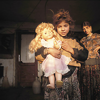 Bosnian girl with her doll. Sarajevo, December 1998.<br />
