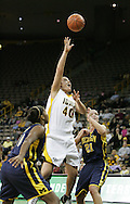08 February 2007: Iowa center Stacy Schlapkohl (40) drive in between Michigan forward Ashley Jones (10) and forward Carly Benson (21) in Iowa's 66-49 win over Michigan at Carver-Hawkeye Arena in Iowa City, Iowa on February 8, 2007.